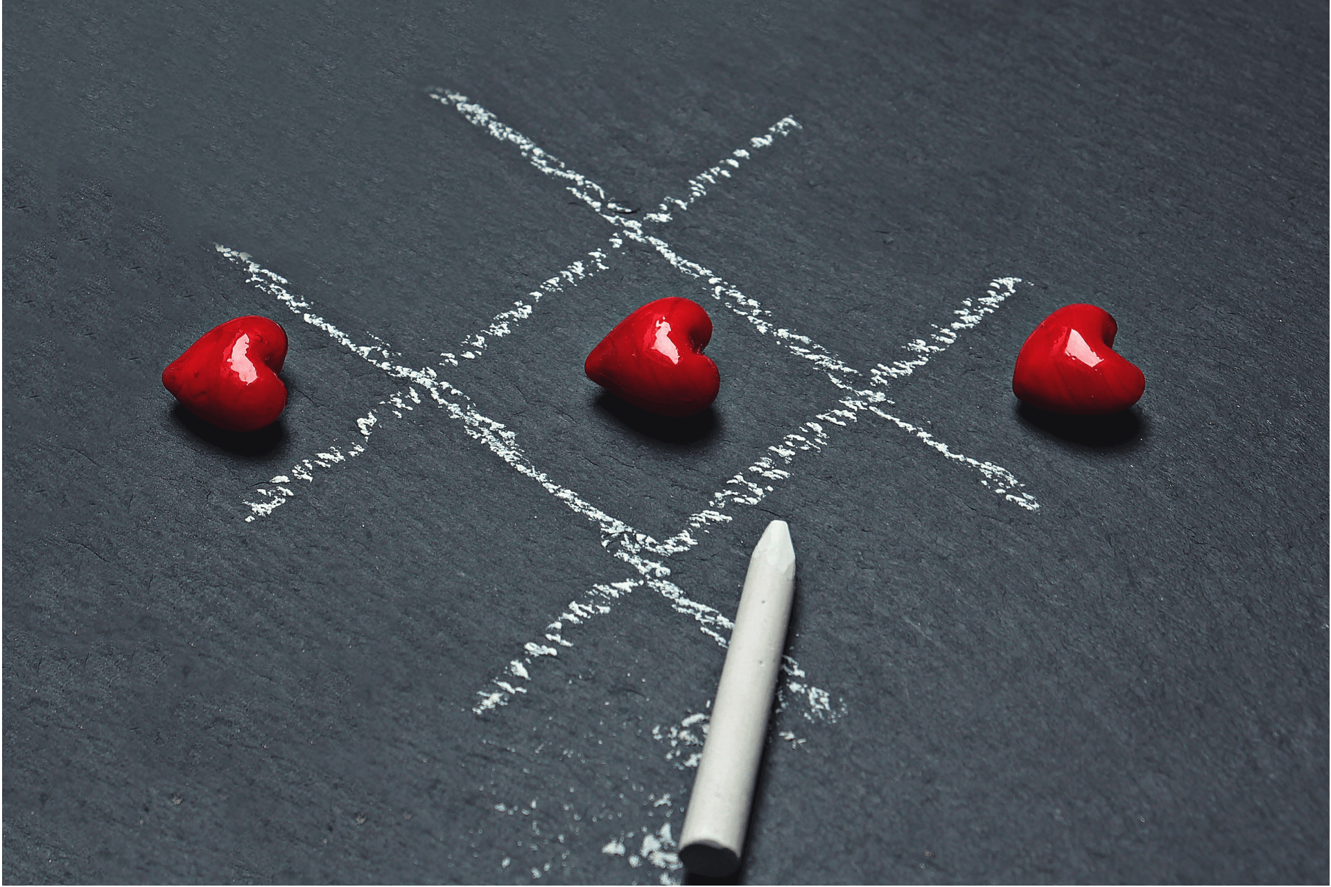 This image depicts 3 hearts on a tic tac toe game, representing the three annual giving strategies for nonprofits explained in the article