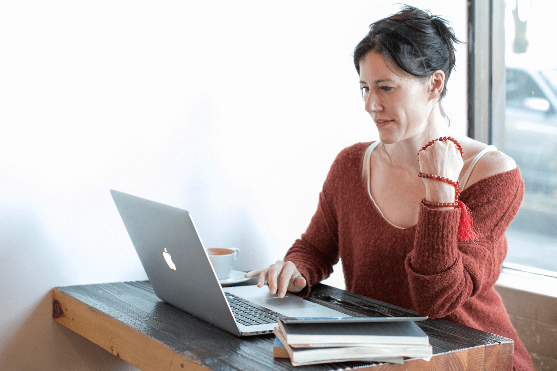 This image depicts a woman making an online donation easily and represents the importance of improving online fundraising for nonprofits