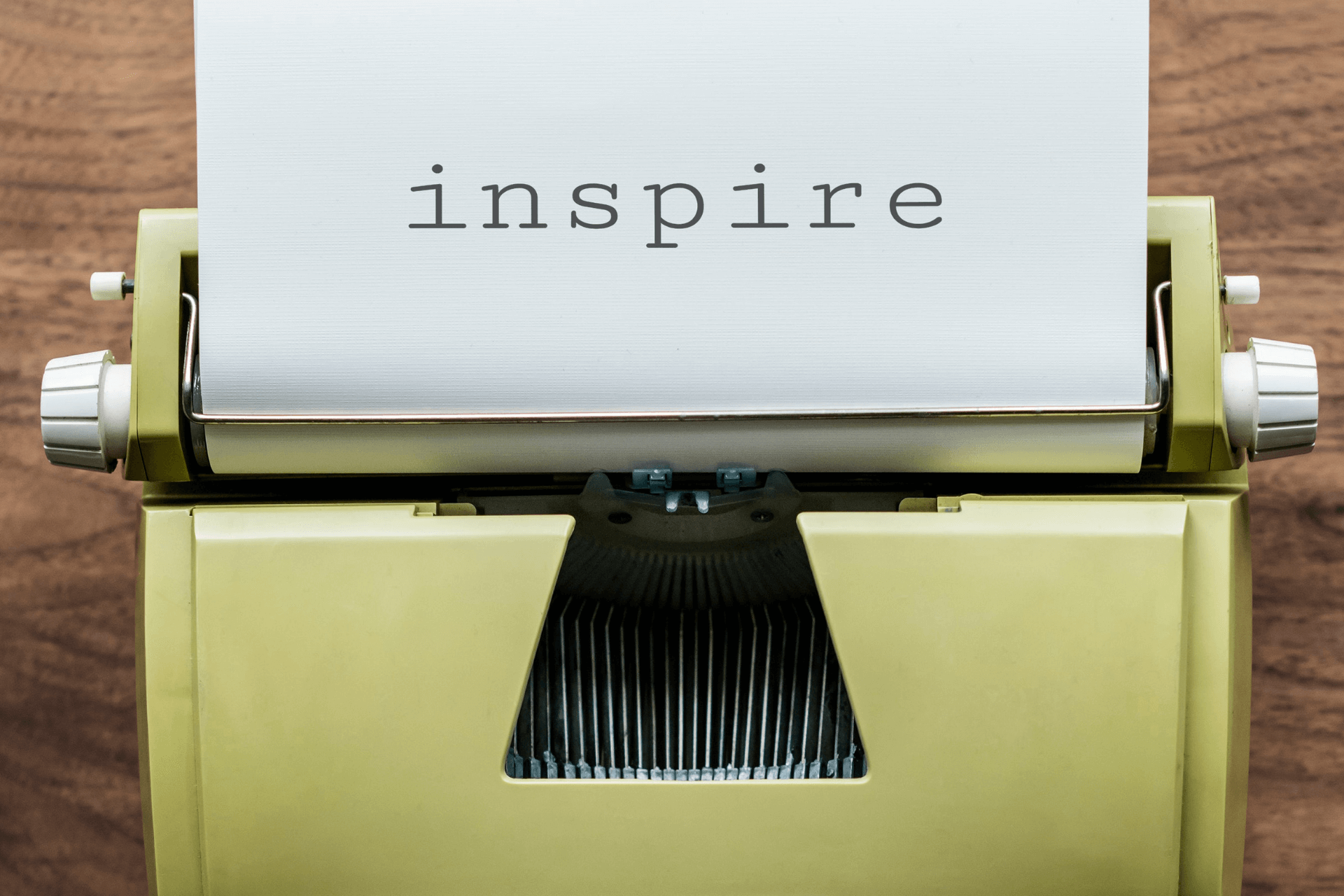 "Word ""inspire"" written on paper with typewriter machine"