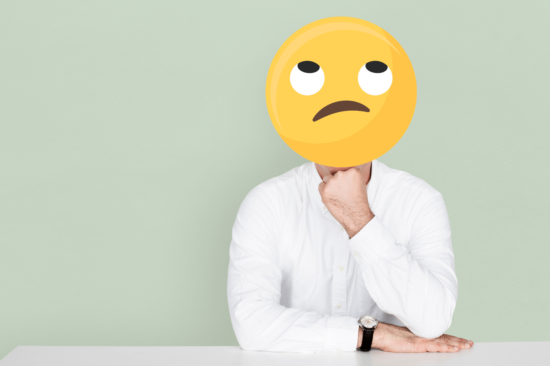 Man body with worried emoji on face