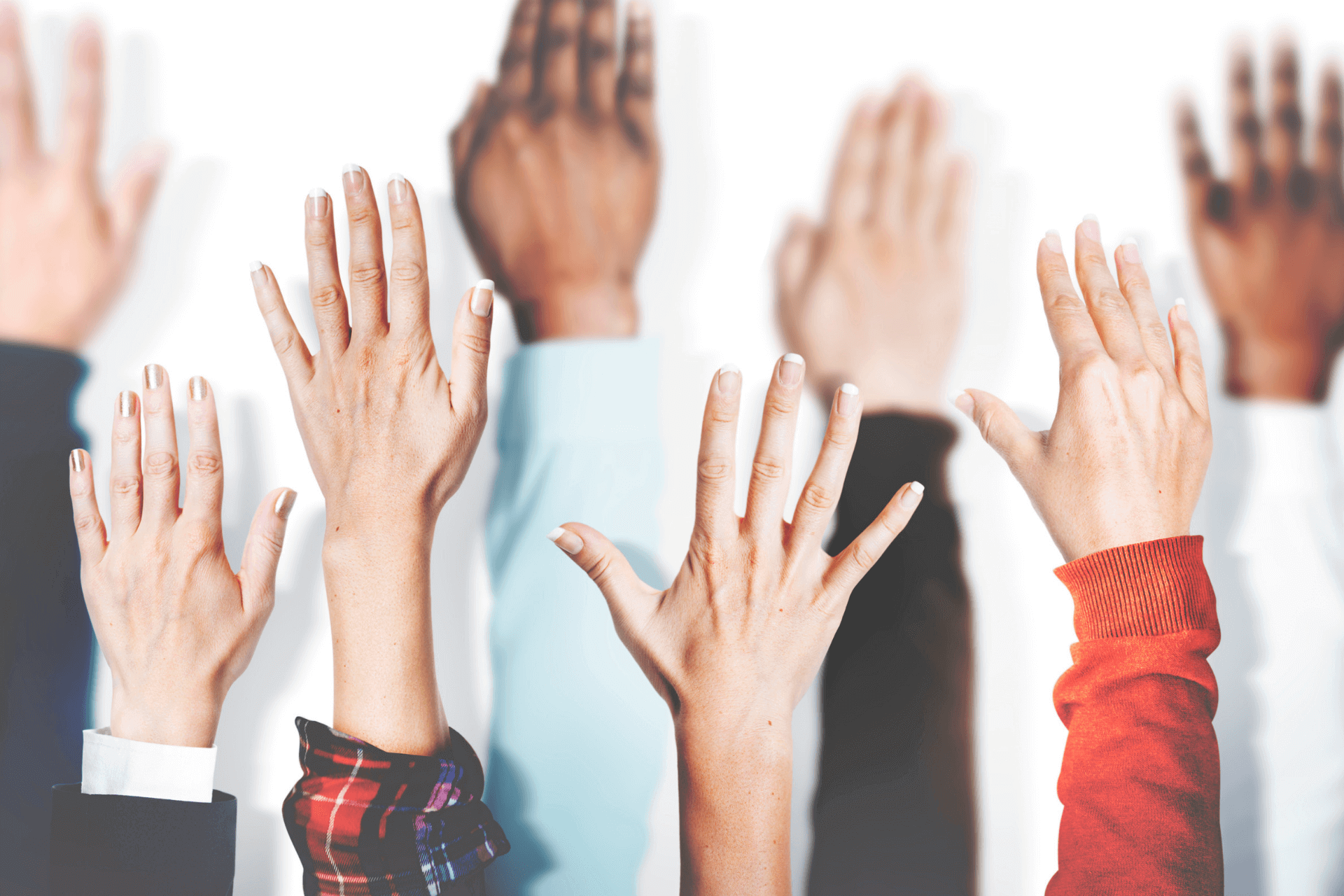 This image shows raised hands supporting the article's idea about successful volunteer programs for nonprofits