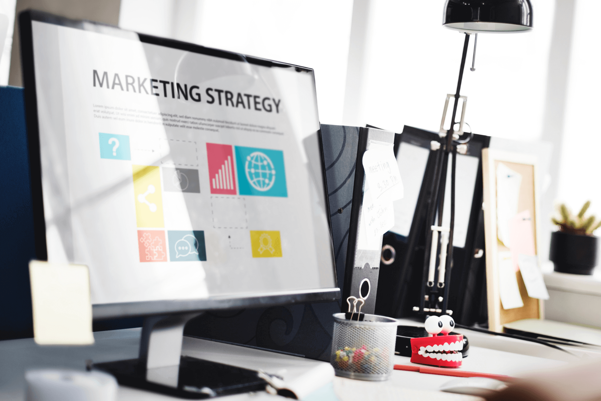 This image depicts a computer screen with the letters marketing strategy