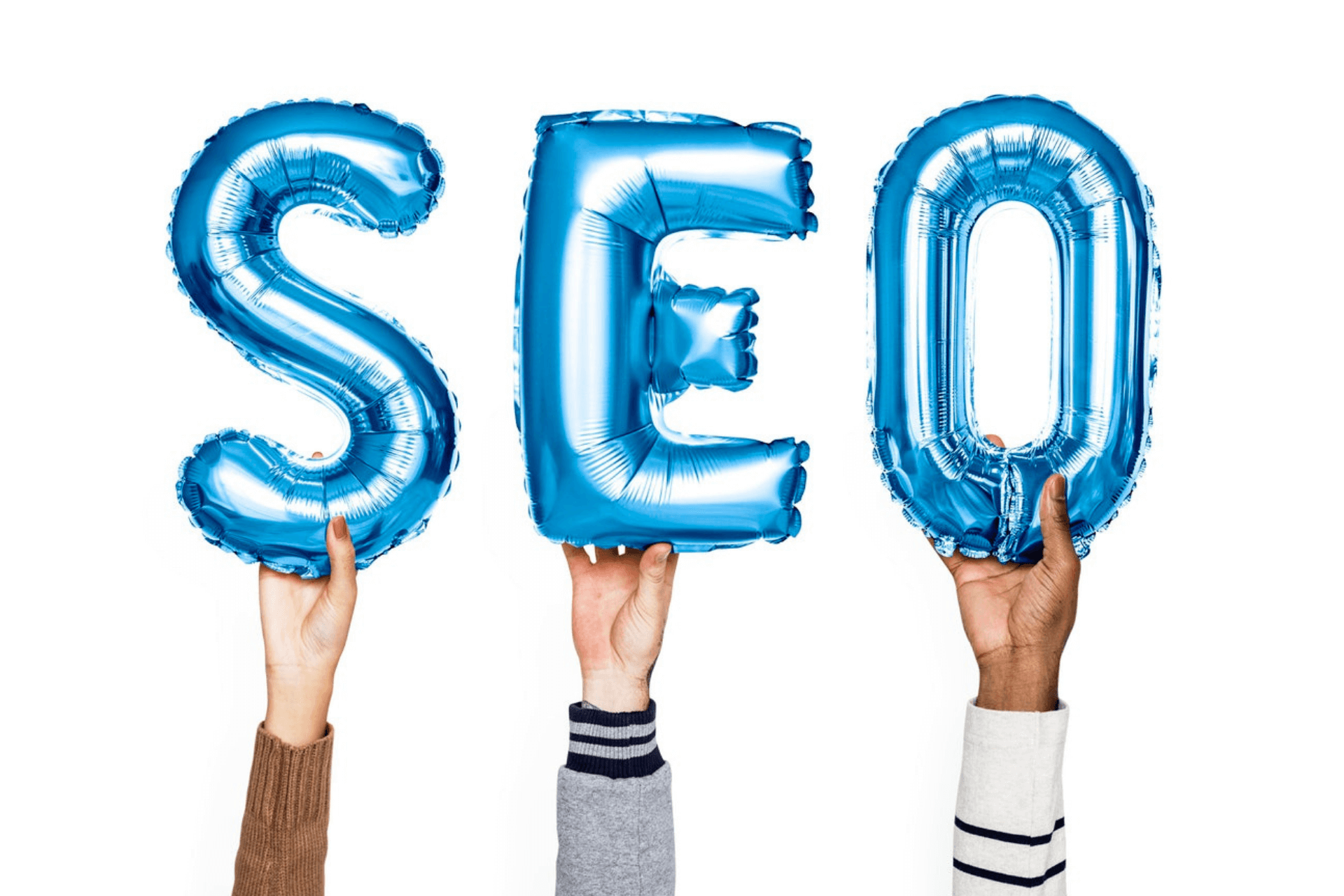 Hands hold each letter of the word SEO