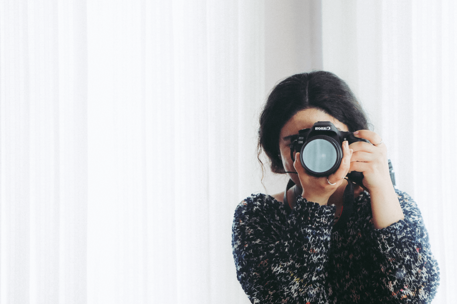 This image portrays a photographer taking a photo shot and represents the importance of good images for social media advertising for nonprofits
