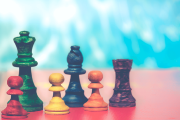 the image shows 5 pawns representing strategy