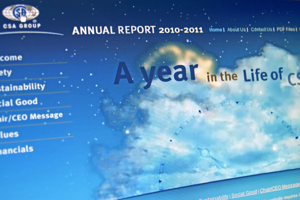 """Screenshot of the annual report displaying """"A year in the life of"""" with clouds in the background."""