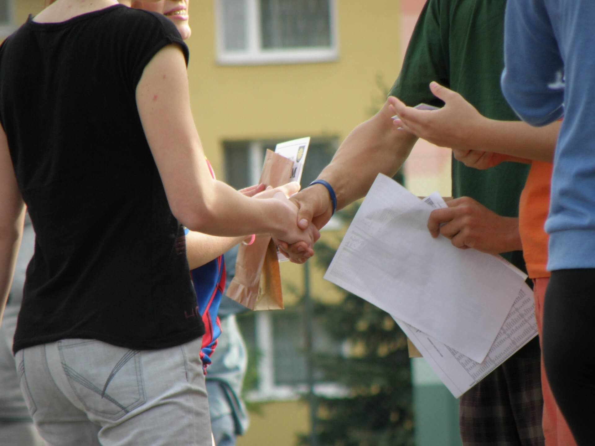 This image displays a handshake and portrays relevance to strategic communications for non-profit donations