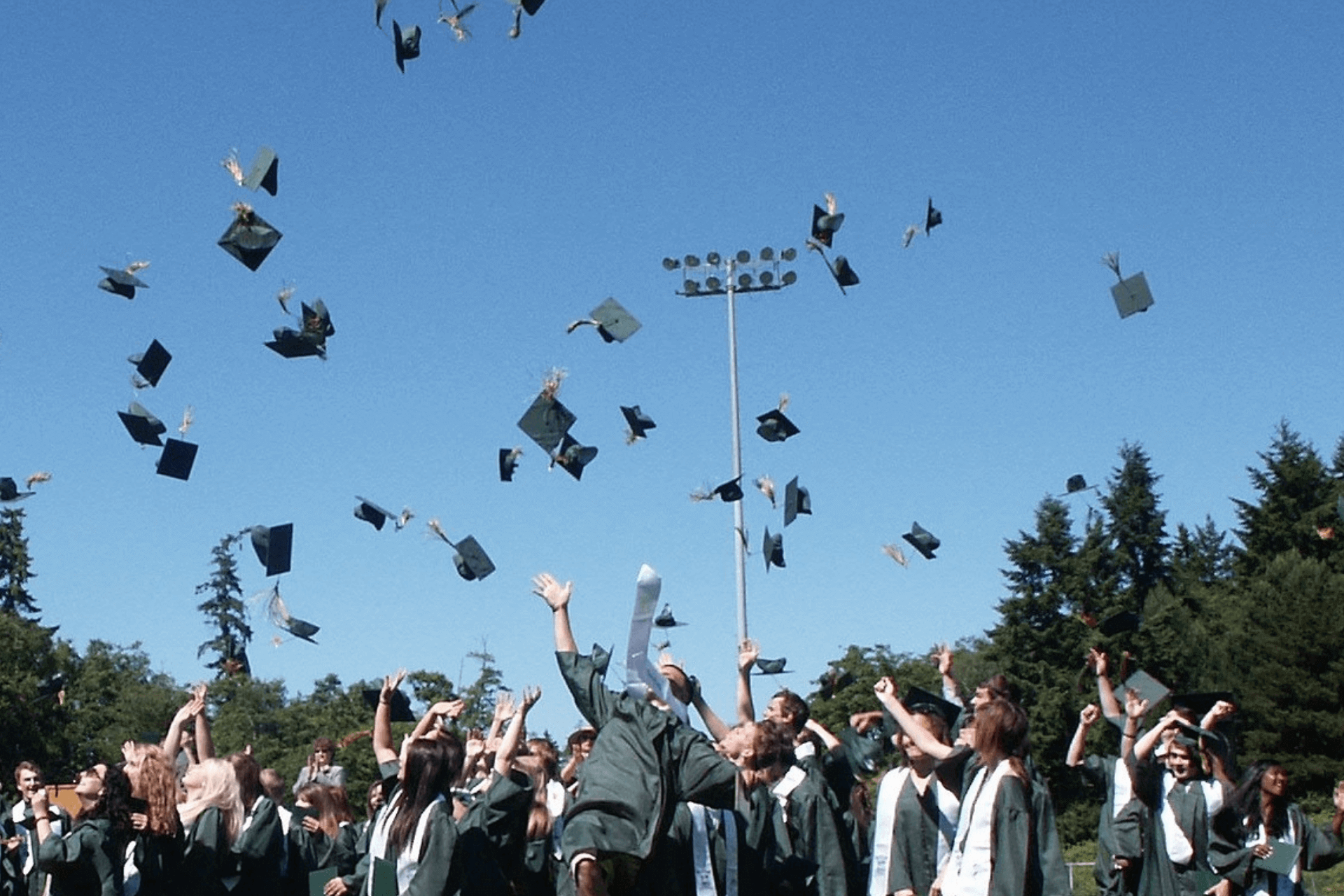 This image portrays students at a graduation ceremony and fits the article about website optimization for educational institutions
