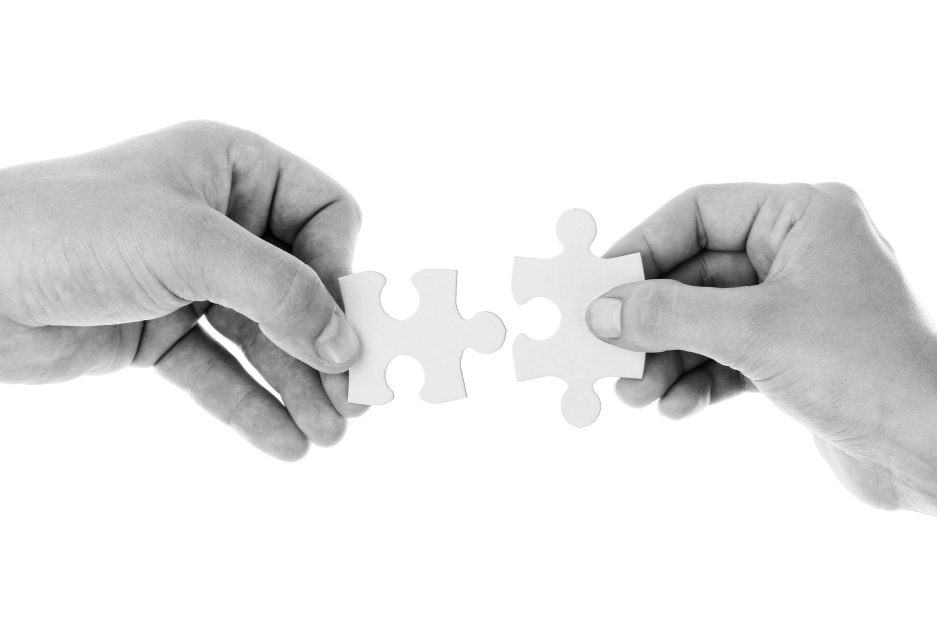This image portrays two puzzle pieces connecting, representing the importance of cause marketing, and nonprofit brand identity for nonprofit business partners