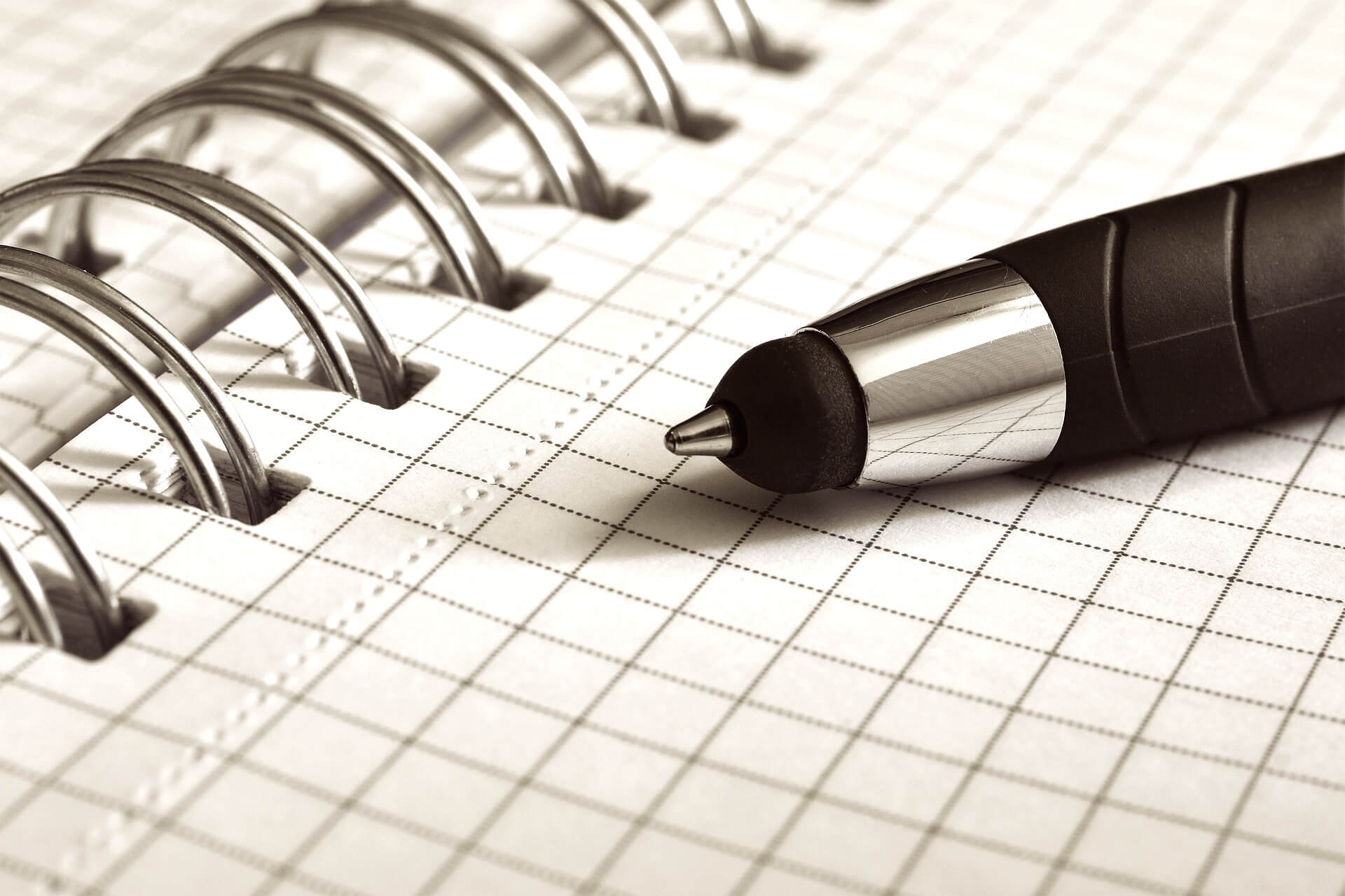This image displays a pen and a notebook and portrays relevance to branding and strategy for non-profit fundraising campaigns